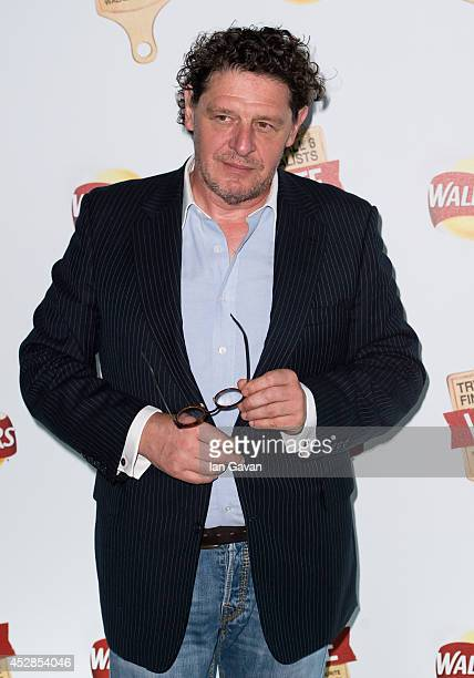 Marco Pierre White attends the Walkers 'Do Us A Flavour' launch party at Paramount Centre Point on July 28 2014 in London England