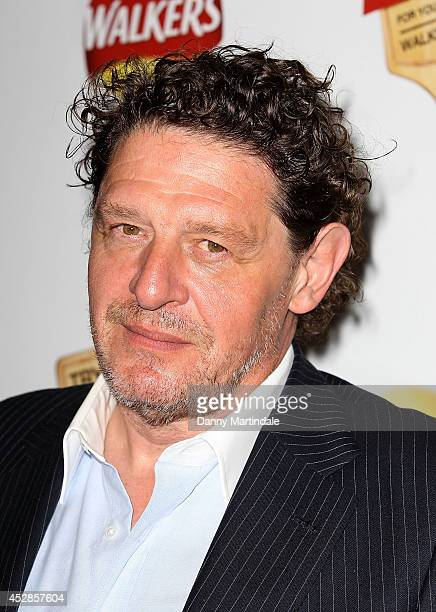 Marco Pierre White attends 'Walkers Do Us A Flavour' launch party at Paramount Centre Point on July 28 2014 in London England