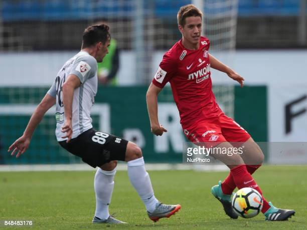 Marco Poletanovic of FC Tosno and Mario Pasalic of FC Spartak Moscow vie for the ball during the Russian Football League match between FC Tosno and...