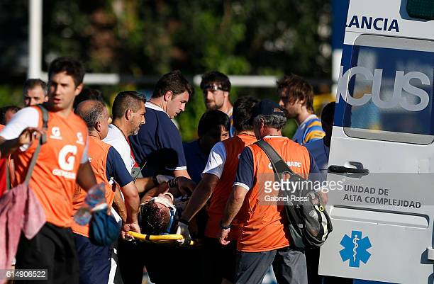 Marco Rebussone of Belgrano Athletic is taking out the field on an ambulance after being injured during a match between Belgrano Athletic and Hindu...