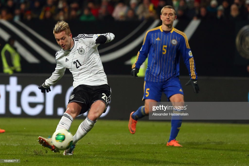 Marco Reis (L) of Germany scores the 4th team goal during the FIFA 2014 World Cup qualifier group C match between Germany and Kazakhstan at Gundig-Stadion on March 26, 2013 in Nuremberg, Germany.