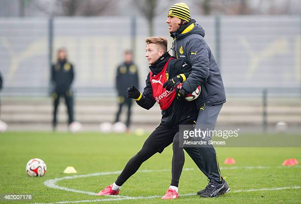 Marco Reus and assistant coach Zeljko Buvac of Borussia Dortmund during a training session at Borussia Dortmund training center on January 23 2015 in...
