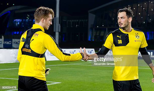 Marco Reus and goalkeeper Roman Buerki of Borussia Dortmund during a video shoot with BVB's media team after a training session during the club's...
