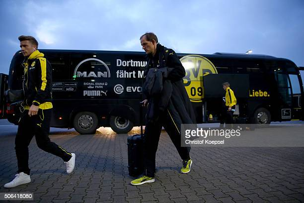 Marco Reus and head coach Thomas Tuchel of Dortmund walk out of the bus prior to the Bundesliga match between Borussia Moenchengladbach and Borussia...