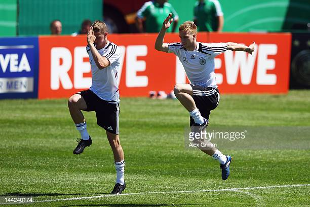 Marco Reus and Lars Bender exercise during a Germany training session at Campo Sportivo Comunale Andrea Dora on May 12 2012 in Abbiadori Italy