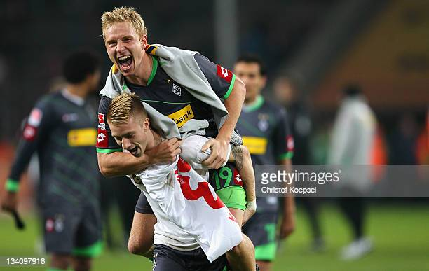 Marco Reus and Mike Hanke of Moenchengladbach celebrate the 30 victory after the Bundesliga match between 1 FC Koeln and Borussia Moenchengladbach at...