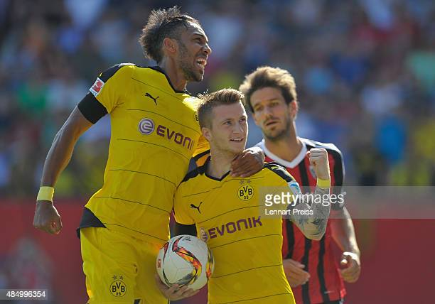 Marco Reus and PierreEmerick Aubameyang of Borussia Dortmund celebrate their team's second goal during the Bundesliga match between FC Ingolstadt and...