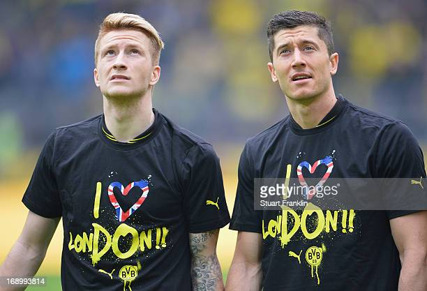 Marco Reus and Robert Lewendowski of Dortmund wear I love London shirts at the end of the Bundesliga match between Borussia Dortmund and TSG 1899...