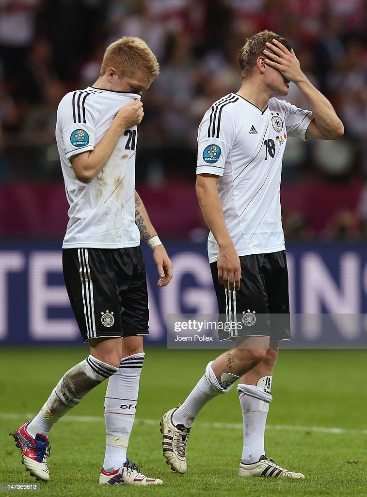 <a gi-track='captionPersonalityLinkClicked' href=/galleries/search?phrase=Marco+Reus&family=editorial&specificpeople=5445884 ng-click='$event.stopPropagation()'>Marco Reus</a> (L) and <a gi-track='captionPersonalityLinkClicked' href=/galleries/search?phrase=Toni+Kroos&family=editorial&specificpeople=638597 ng-click='$event.stopPropagation()'>Toni Kroos</a> of Germany show their dejection after the UEFA EURO 2012 semi final match between Germany and Italy at the National Stadium on June 28, 2012 in Warsaw, Poland.