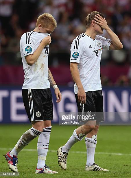 Marco Reus and Toni Kroos of Germany show their dejection after the UEFA EURO 2012 semi final match between Germany and Italy at the National Stadium...