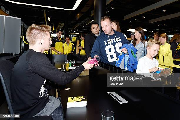 Marco Reus attends an autograph session at Borussia Dortmund FanWelt on October 8 2014 in Dortmund next to Signal Iduna Park Germany