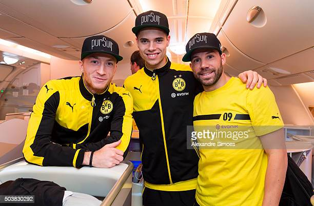 Marco Reus Julian Weigl and Gonzalo Castro of Borussia Dortmund on the plane before heading to their training camp in Dubai on January 07 2016 in...