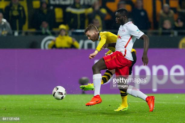 Marco Reus of Borussia Dortmund and Dayot Upamecano of RB Leipzig battle for the ball during the Bundesliga soccer match between Borussia Dortmund...