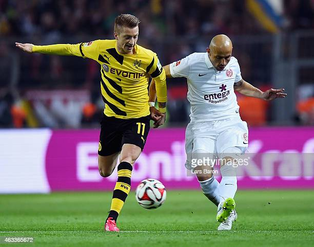 Marco Reus of Borussia Dortmund and Elkin Soto of 1 FSV Mainz 05 battle for the ball during the Bundesliga match between Borussia Dortmund and 1 FSV...