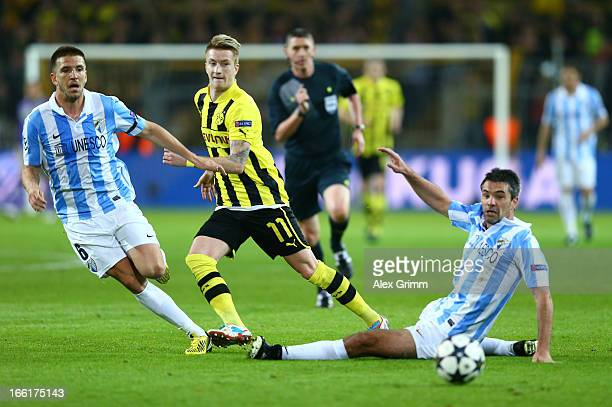 Marco Reus of Borussia Dortmund and Jeremy Toulalan of Malaga and Ignacio Camacho of Malaga in action during the UEFA Champions League quarterfinal...