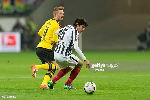 Marco Reus of Borussia Dortmund and Jesus Vallejo of Eintracht Frankfurt battle for the ball during the Bundesliga match between Eintracht Frankfurt...
