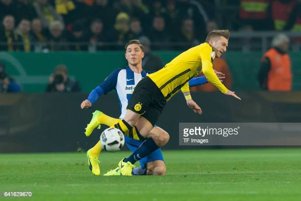 Marco Reus of Borussia Dortmund and Niklas Stark of Hertha BSC battle for the ball during the DFB Cup Round Of 16 match between Borussia Dortmund and...
