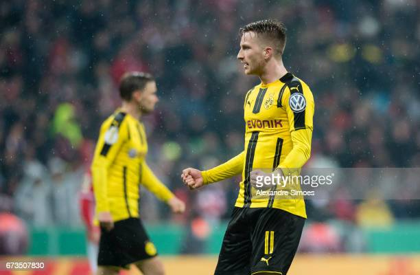 Marco Reus of Borussia Dortmund celebrates after Ousmane Dembele scored the goal to the 23 during the DFB Cup Semi Final match between FC Bayern...