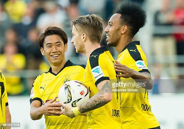 Marco Reus of Borussia Dortmund celebrates after scoring his team's second goal with PierreEmerick Aubameyang and Shinji Kagawa during the preseason...