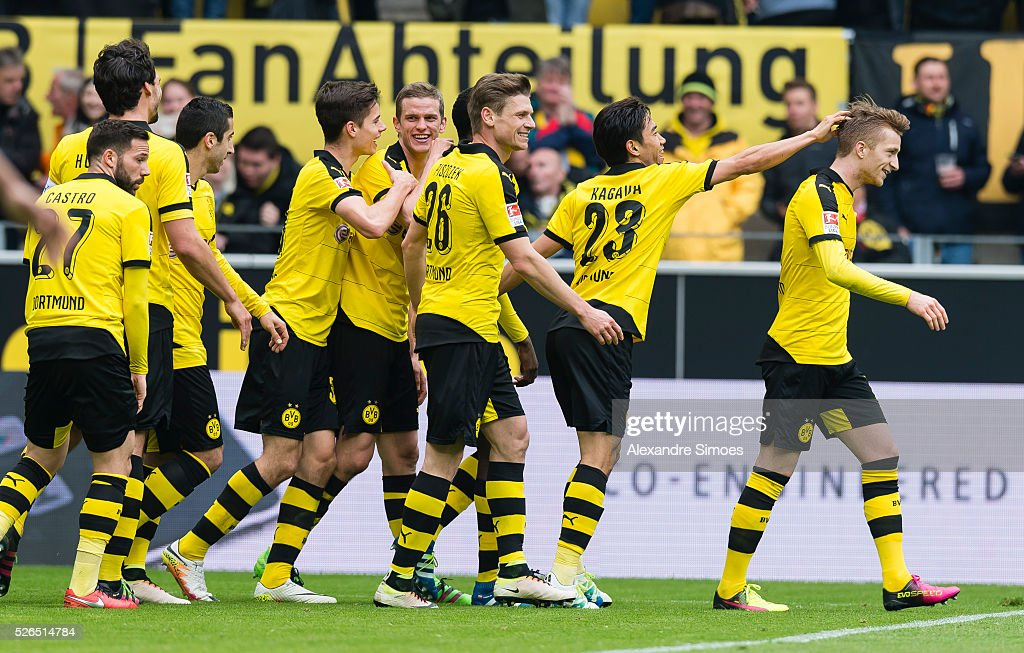 Marco Reus (R) of Borussia Dortmund celebrates after scoring the goal to the 3:0 together with his team mates during the Bundesliga match between Borussia Dortmund and VfL Wolfsburg at Signal Iduna Park on April 30, 2016 in Dortmund, Germany.