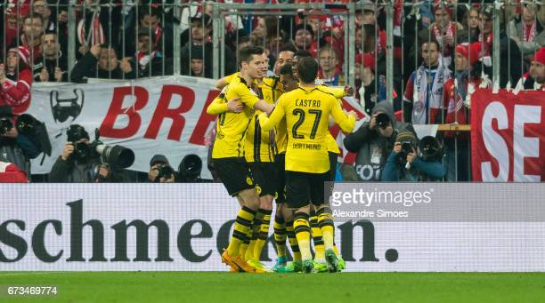 Marco Reus of Borussia Dortmund celebrates after scoring the opening goal with his team mates during the DFB Cup Semi Final match between FC Bayern...