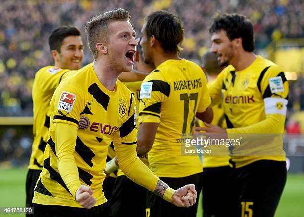 Marco Reus of Borussia Dortmund celebrates after team mate Henrikh Mkhitaryan of Borussia Dortmund scored his teams second goal during hte Bundesliga...
