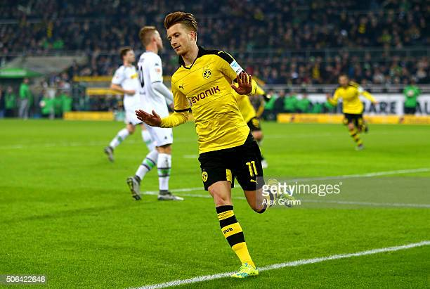 Marco Reus of Borussia Dortmund celebrates as he scores their first goal during the Bundesliga match between Borussia Moenchengladbach and Borussia...