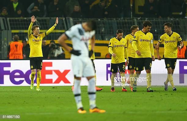 Marco Reus of Borussia Dortmund celebrates as he scores their third goal during the UEFA Europa League Round of 16 first leg match between Borussia...