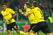 Marco Reus of Borussia Dortmund celebrates his goal with his teammate Ciro Immobile during the UEFA Champions League Round of 16 match between...