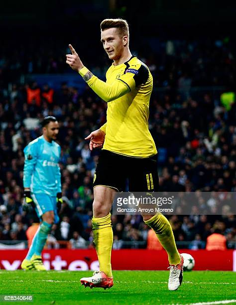 Marco Reus of Borussia Dortmund celebrates scoring his sides second goal during the UEFA Champions League Group F match between Real Madrid CF and...