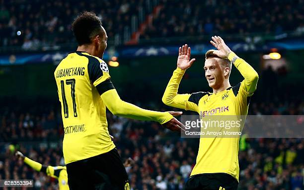Marco Reus of Borussia Dortmund celebrates scoring his sides second goal with PierreEmerick Aubameyang of Borussia Dortmund during the UEFA Champions...