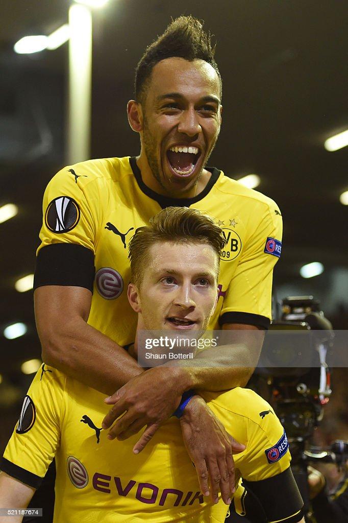 Marco Reus of Borussia Dortmund celebrates scoring his team's third goal with PierreEmerick Aubameyang during the UEFA Europa League quarter final...