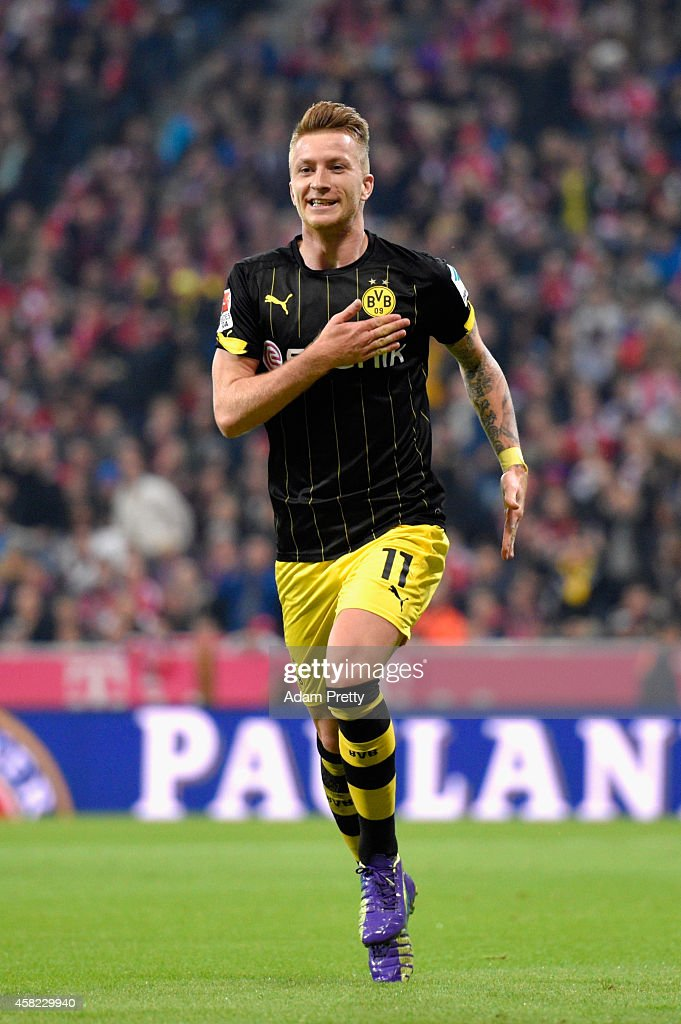Marco Reus of Borussia Dortmund celebrates scoring the first goal during the Bundesliga match between FC Bayern Muenchen and Borussia Dortmund at Allianz Arena on November 1, 2014 in Munich, Germany.