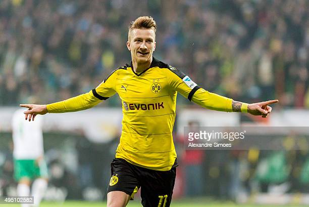 Marco Reus of Borussia Dortmund celebrates scoring the goal to make it 13 during the Bundesliga match between Werder Bremen and Borussia Dortmund at...