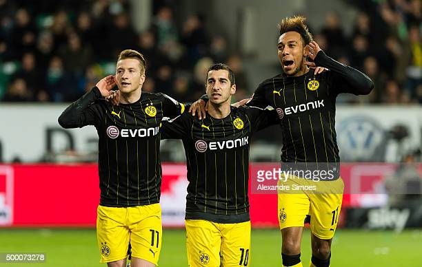 Marco Reus of Borussia Dortmund celebrates scoring the opening goal together with his team mates Henrikh Mkhitaryan and PierreEmerick Aubameyang...