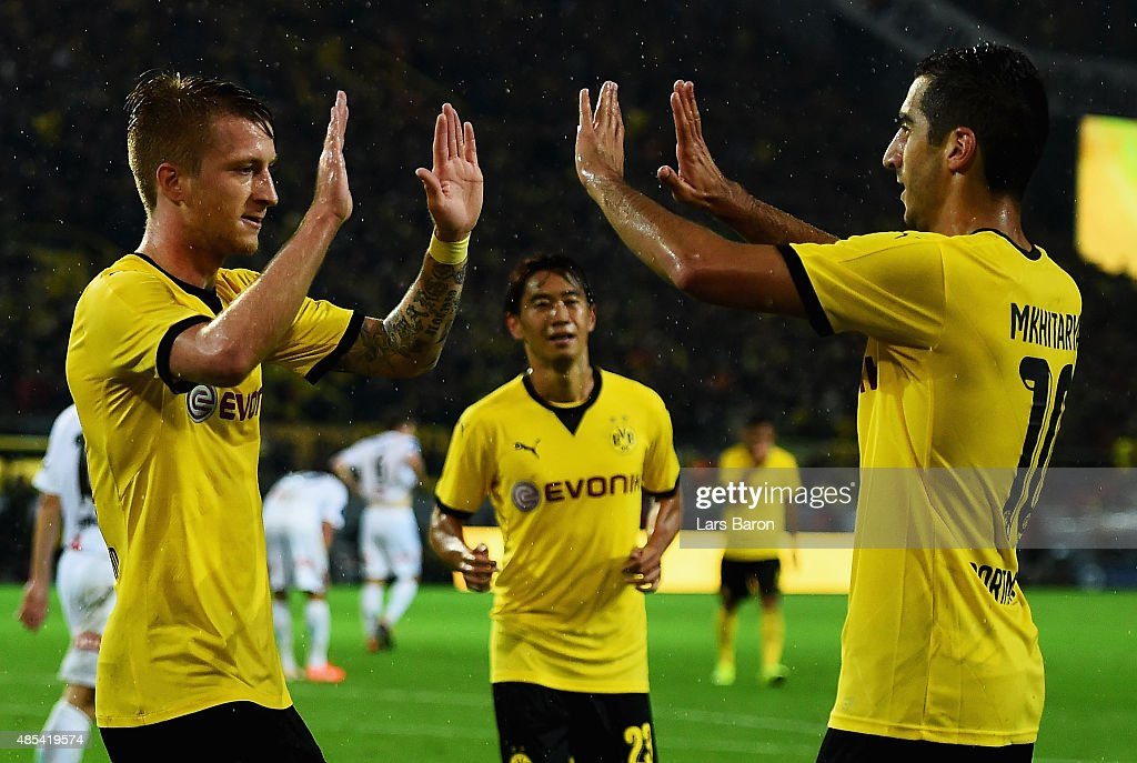 Marco Reus of Borussia Dortmund celebrates with Henrikh Mkhitaryan of Borussia Dortmund after scoring his teams third goal the UEFA Europa League...