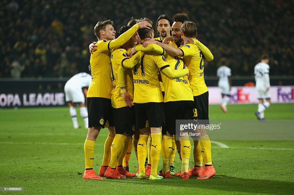 Marco Reus of Borussia Dortmund (11) celebrates with team mates as he scores their third goal during the UEFA Europa League Round of 16 first leg match between Borussia Dortmund and Tottenham Hotspur at Signal Iduna Park on March 10, 2016 in Dortmund, Germany.