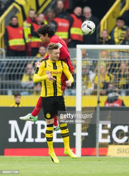 Marco Reus of Borussia Dortmund challenges Jesus Vallejo of Eintracht Frankfurt during the Bundesliga match between Borussia Dortmund and Eintracht...