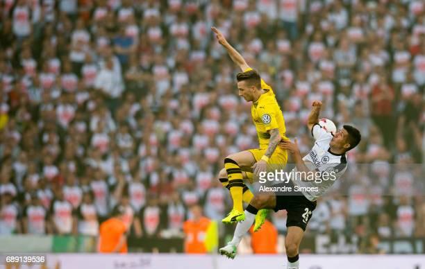 Marco Reus of Borussia Dortmund challenges Mijat Gacinovic of Eintracht Frankfurt during the DFB Cup Final match between Eintracht Frankfurt and...