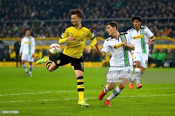 Marco Reus of Borussia Dortmund flicks the ball past Andreas Christensen of Borussia Moenchengladbach during the Bundesliga match between Borussia...