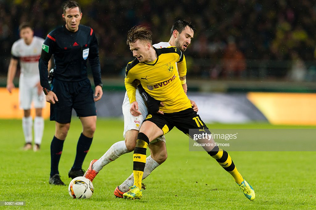 Marco Reus of Borussia Dortmund gets challenged by Lukas Rupp of Stuttgart during the DFB Cup match between VfB Stuttgart and Borussia Dortmund at Mercedes-Benz Arena on February 09, 2016 in Stuttgart, Germany.