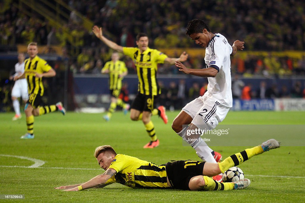 <a gi-track='captionPersonalityLinkClicked' href=/galleries/search?phrase=Marco+Reus&family=editorial&specificpeople=5445884 ng-click='$event.stopPropagation()'>Marco Reus</a> of Borussia Dortmund goes down under the challenge from <a gi-track='captionPersonalityLinkClicked' href=/galleries/search?phrase=Raphael+Varane&family=editorial&specificpeople=7365948 ng-click='$event.stopPropagation()'>Raphael Varane</a> of Real Madrid in the area during the UEFA Champions League semi final first leg match between Borussia Dortmund and Real Madrid at Signal Iduna Park on April 24, 2013 in Dortmund, Germany.