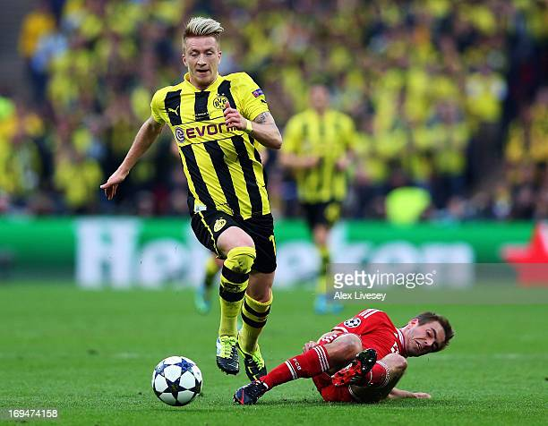 Marco Reus of Borussia Dortmund in action with Philipp Lahm of Bayern Muenchen during the UEFA Champions League final match between Borussia Dortmund...