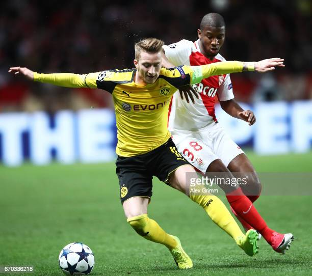 Marco Reus of Borussia Dortmund is challenged by Almamy Toure of Monaco during the UEFA Champions League Quarter Final second leg match between AS...