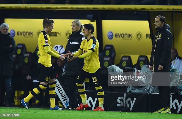 Marco Reus of Borussia Dortmund is replaced by substitute Shinji Kagawa as Thomas Tuchel manager of Borussia Dortmund looks on during the Bundesliga...