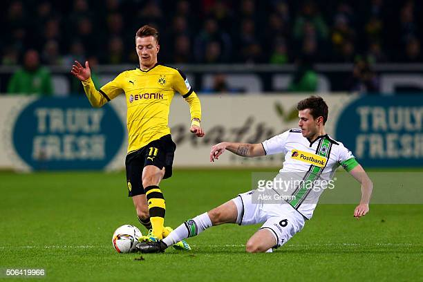 Marco Reus of Borussia Dortmund is tackled by Havard Nordtveit of Borussia Moenchengladbach during the Bundesliga match between Borussia...