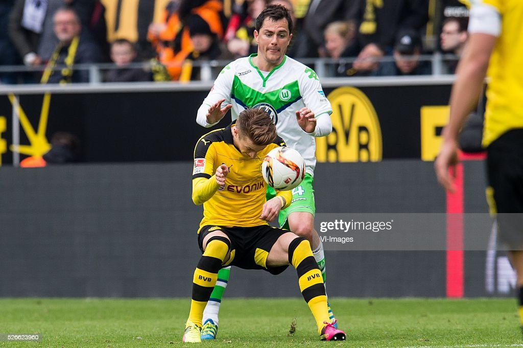 Marco Reus of Borussia Dortmund, Marcel Sch��fer of VFL Wolfsburg during the Bundesliga match between Borussia Dortmund and VfL Wolfsburg on April 30, 2016 at the Signal Idun Park stadium in Dortmund, Germany.