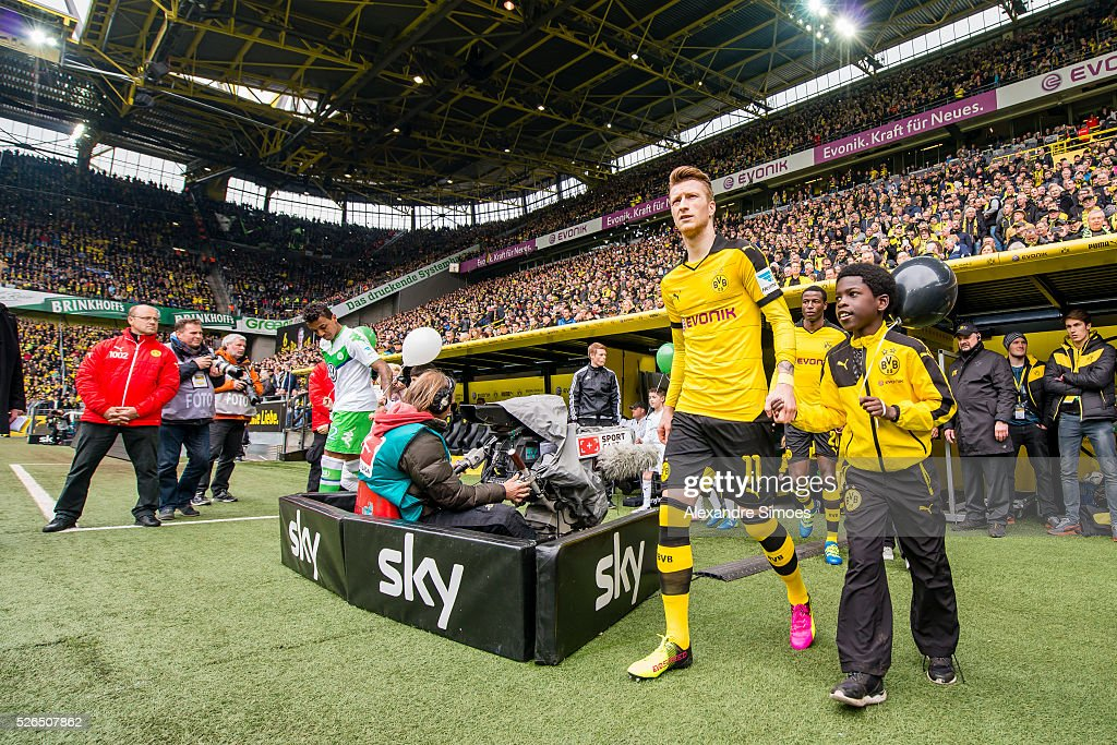 Marco Reus of Borussia Dortmund on his way to the green prior to the Bundesliga match between Borussia Dortmund and VfL Wolfsburg at Signal Iduna Park on April 30, 2016 in Dortmund, Germany.