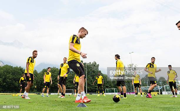Marco Reus of Borussia Dortmund playing with a small children's ball during a training session ot the training ground of Bad Ragaz on July 23 2015 in...