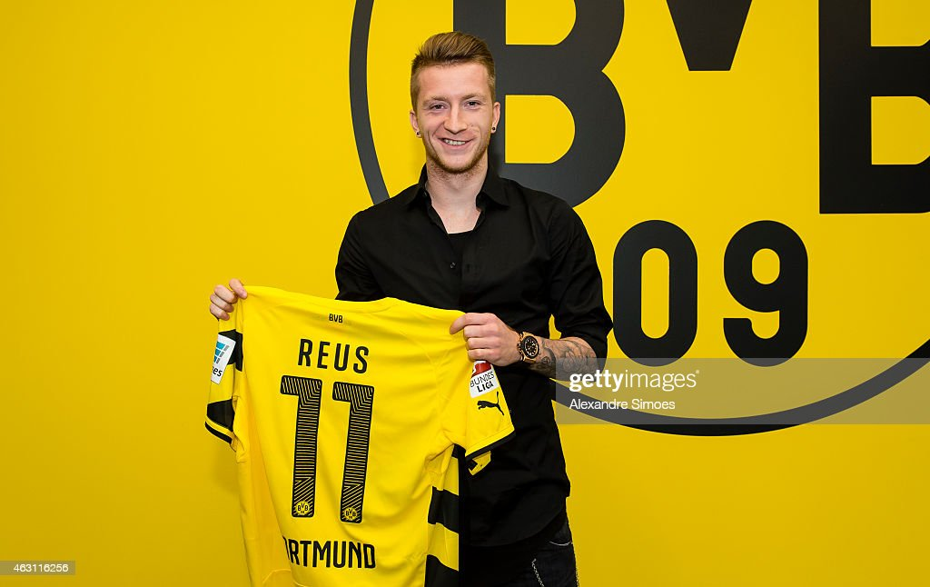 <a gi-track='captionPersonalityLinkClicked' href=/galleries/search?phrase=Marco+Reus&family=editorial&specificpeople=5445884 ng-click='$event.stopPropagation()'>Marco Reus</a> of Borussia Dortmund poses with his shirt after his contract extension during Borussia Dortmund's press conference at Signal Iduna Park on February 10, 2015 in Dortmund, Germany.